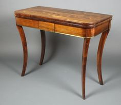 """Lot 1206, A Regency D shaped inlaid brass card table raised on sabre supports 29""""h x 36""""w x 18""""d, est £600-800"""