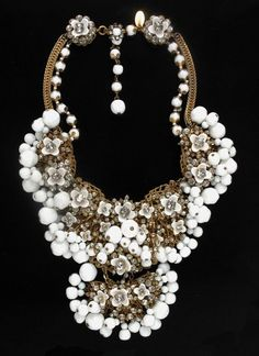 Miriam Haskell White Glass Bib Necklace:  American, circa 1950  -  Antique gilt-metal findings and chain, white glass regular and irregular beads, clear rhinestones, in densely applied floral motif with fringe of white beads, 14 1/2 x 3 inches, marked: Miriam Haskell.
