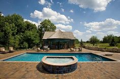 Modern Pool Design by Classic Pool & Patio with attached gunite spa and beautiful lighting features.