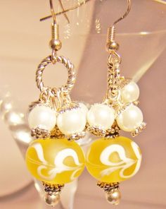 http://www.artfire.com/ext/shop/product_view/princessdesignsjewelry/1315570/pearls_and_swirls_on_yellow_earrings/handmade/jewelry/earrings/lampwork 17.84