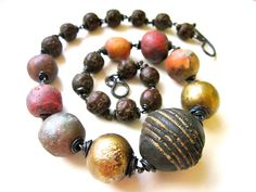 A Story of Giants - primitive assemblage faux raku ceramic art beads antique African clay brass trade beads wood oxidized copper necklace (96.00 USD) by LoveRoot - handmade - jewelry - jewellery - artisan --- inviciti charms