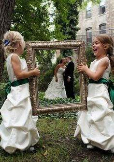 Flower girl and ring bearer holding the frame?