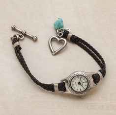 """To wear on Thursdays! DIY from one of those old watch fases - braided brown Italian leather band kissed with a sterling silver heart toggle clasp and turquoise nugget. 7-1/2""""L"""