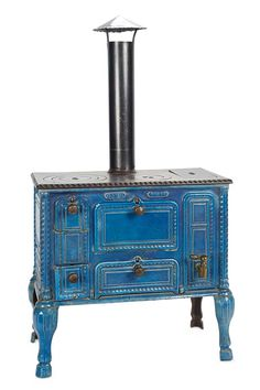 French enameled cast iron stove with brass fittings, by Godin et Cie, labeled Godin Guise, late 19th century. Located in Guise, France, Godin and Cie was one of the largest maker's of kitchen and parlor stoves throughout the 19th century. The doll-sized stoves such as this were made as salesman's samples with elaborate authentic detailing of the people-sized versions.