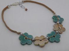 beige ceramic flowers jewelry designer shades of green