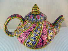 Acrylic painted teapot.