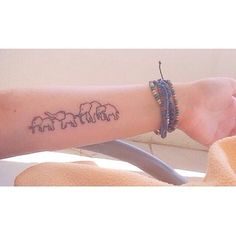 cute small elephant family tattoo on inner arm
