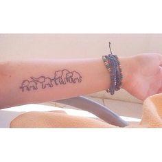 cute small elephant family tattoo on inner arm