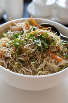 Quick and Easy Filipino Pancit Recipe - rice noodles stir fried with chicken breast, cabbage, carrots, garlic, and soy sauce.