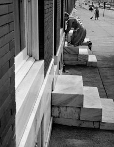 Woman on those famous marble steps, Baltimore, Maryland, 1954