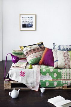 Kantha Quilts so very clever, notice the lamp clipped to packing crate