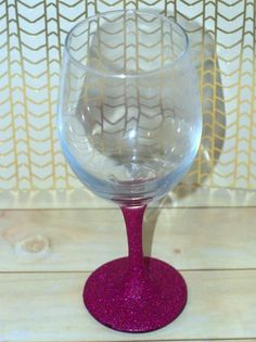 Sparkle makes everything better. These glittered wine glasses are no different. As we all know, glitter makes everything better. A lot of people refer to glitter as the herpes of craft projects, but I don't feel that way. Nope. You just have to treat glitter right, and it will make you happy beyond measure. I mean, I love me some glitter craft projects. Lately, I've been seeing these glitter wine glasses all over the place. Since I do love glitter, I decided that I needed these glittered… Wood Wine Racks, Storage Solutions, Wine Delivery, Wine Glass, Tableware, Dinnerware, Tablewares, Wooden Wine Racks, Porcelain Ceramics