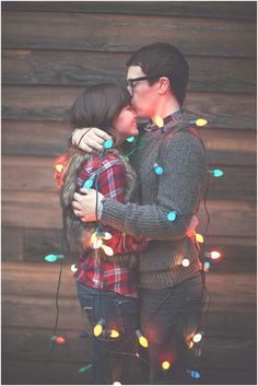 Wrapped up in lights! Cute couples Christmas picture!