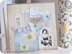 """Basic Grey weekly challenge """"solid papers only"""" - I love the butterflies, the tags, and the single photo.  Keisha Campbell."""