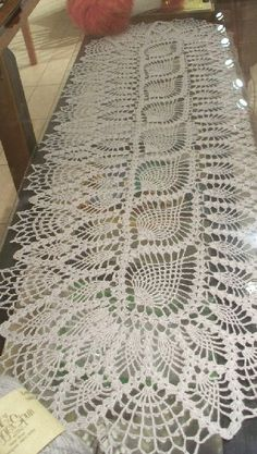 I have NO IDEA if there's a pattern available for this. It's just gorgeous. (pineapple crochet runner)