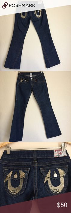 "True Religion Joey Jeans True Religion Joey flared jeans in a dark wash. In good preloved condition.  Has been hemmed to current length. Approx Measurements Inseam-30.5"" Rise-7"" Leg opening-9"" Waist-14.5"" True Religion Jeans Flare & Wide Leg"