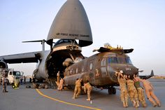 File:U.S. Army National Guard soldiers push a CH-47 Chinook helicopter into a U.S. Air Force C-5 Galaxy as they prepare to return home to th...
