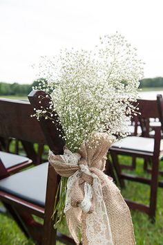 Decorate your aisle with burlap, lace, and baby's breath. | Claire Pacelli Photography