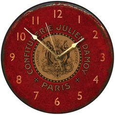red clock advertising a Paris confectioner