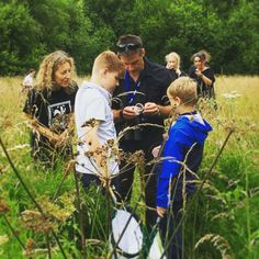 School children bug hunting with Nick Baker in the meadow at Nottinghamshire Wildlife Trusts' Idle Valley Nature Reserve thanks to support from players of People's Postcode Lottery