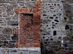 bricked doorway in vintage stone wall