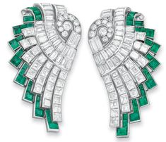 Art Deco Diamond And Emerald Clip Brooches Mounted In Platinum And White Gold And Signed Hennell (2)   c.1930 1930 christies