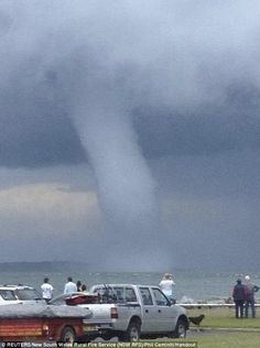 People look at a waterspout close to the shoreline near Batemans Bay, about 140 miles south of Sydney, Australia on Nov. The Australian Bureau of Meteorology issued a gale warning and forecast rough seas for the coastal region that includes Batemans Bay. Weather Storm, Weather Cloud, Wild Weather, Tornados, Natural Phenomena, Natural Disasters, Pictures Of The Week, Cool Pictures, Tornado Pictures