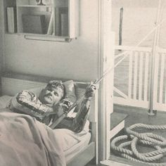 Stiltsville: Commodore Ed Turner creator of the famed Quarterdeck Club, fishing in bed during its 1940s heyday