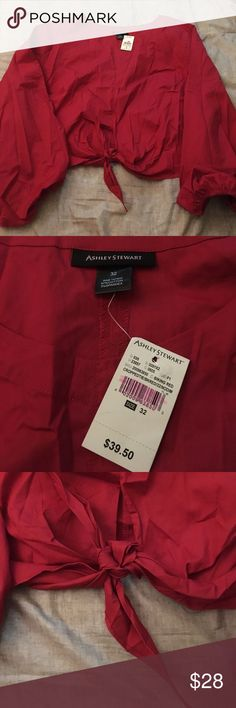 Ashley Stewart red stylish blouse sz 32 Really cute brand new Ashley Stewart red blouse . It ties up in the front . The material is very breathable great for any season to wear . This is a size 32 . If you have any questions please don't hesitate to ask . Ashley Stewart Tops Blouses