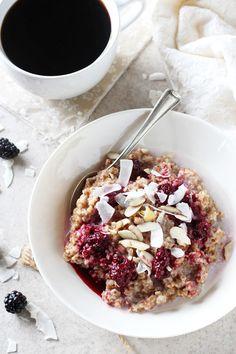 Recipe for creamy blackberry coconut bulgur breakfast bowl. With whole grain bulgur as the base and topped with a blackberry sauce, coconut and nuts!