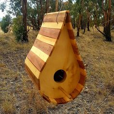 Unique Tasmanian Huon Pine & Myrtle Birdhouse. Hand crafted from beautiful Tasmanian specialty timbers. Hung with a stainless steel cable and fittings this birdhouse will last a lifetime and give your birds a home of elegance. Measurements: 320mm high 180mm wide 240mm deep