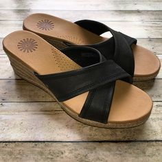 🎉HP🎉 UGG 'Gwyn' espadrille wedge sandal NIB UGG Australia SZ 7 'Gwyn' Espadrille Sandal. Finished with a gum rubber sole, this wedge slide sandal has a crisscrossing band, lightly textured leather upper atop a leather-covered, EVA and Poron foam-cushioned footbed. The jute-wrapped wedge heel delivers flattering elevation that doesn't compromise your heightened comfort level. ¾'' platform & 2'' heel. Stitching and UGG logo details + authenticity hologram. NEW. NEVER WORN. In original box…