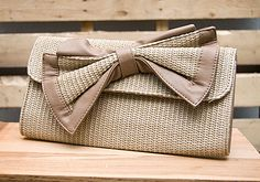 Straw Bow Clutch with detachable chain // $31.99 // shopboldthreads.com // #bold #threads #boldthreads #purse #clutch #accessories #fashion #tan #beige #bow