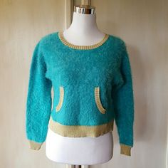 Eyelash Juicy Couture Gold and Teal Sweater This gorgeous sweater has to be felt to be believed! It is so luxuriously soft and the color is insatiable! Worn twice & professionally laundered, it is in mint condition! It falls right above the waist line. Juicy Couture Sweaters Crew & Scoop Necks