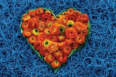 """Monday Hearts for Madalene    From artist Page Hodel's """"Monday Hearts for Madalene"""" series. The beautiful hearts are made in memory of Page's partner Madalene Rodriguez, who was tragically lost to ovarian cancer.Rubber Bands and Ranunculus"""