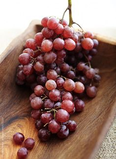 Red grapes in wood bowl  by trinettereed | Stocksy United