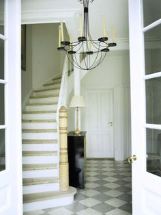 curved white stairway at entrance