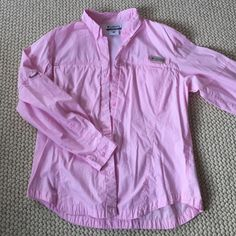 Columbia PFG Beautiful pink Columbia PFG shirt in a ladies large. Complete with two pockets on the chest that zip up to hold belongings. Worn a few times. Columbia Tops Button Down Shirts