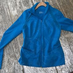 Aqua blue fitness jacket Fitness jacket that has a great fit because it has spandex. I'm in fitness so I have a bunch of these kinds of jackets. This is Zella so great product. Also has mesh inserts and holes for thumbs. Zella Jackets & Coats Utility Jackets