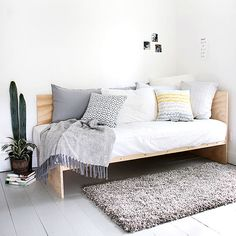 Functionality is paramount in Scandinavian design, so furniture that pulls double (or triple) duty is essential. This bed, for example, feels very European with its dual sleeping and lounging functionality. Styled with sparse artwork and finished in a simple gray color scheme, the look is utterly Scandinavian and so easy to replicate./