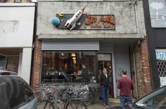 Brick facade and space-art sign invite you to stylish coffee shop in Toronto. Jet Fuel is all about originality. Interior photos inside the review http://torontoism.com/toronto-news/2016/02/jet-fuel-coffee