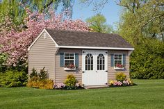 The extra special touches like the flower boxes and glass in the doors make this Quaker shed a true beauty! Vinyl Storage Sheds, Vinyl Sheds, Shed Storage, Built In Storage, Shed Cost, Amish Sheds, Lakeside Living, White Trim, Pastor