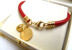High quality Italian red embroidered nappa leather      See description below:      • Italian red embroidered leather cord 4 mm    • 14 k gold