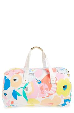 How cute is this canvas duffel bag in a bright and fun floral print?