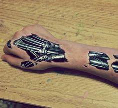 16 Most Absurd Tattoos of All Time - - Minimalist Tattoo Tattoos Bras, Hand Tattoos, Body Art Tattoos, Sleeve Tattoos, Time Tattoos, Biomech Tattoo, Cyborg Tattoo, Backpiece Tattoo, Biomechanical Tattoos