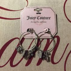 🎀 Juicy Couture silver w charms earrings 🎀💯 Juicy couture silver hoop with charms earrings!!! Brand 🆕 ❤️.  🚫trades Juicy Couture Accessories