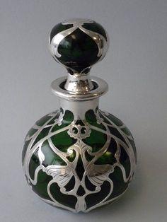 Art Nouveau silver and glass perfume bottle