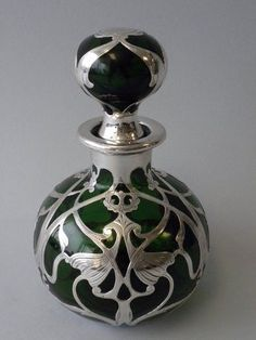 Art Nouveau silver and glass perfume bottle...