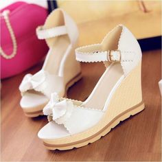 White platform wedges with bow details
