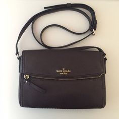Kate Spade Cobble Hill Mini Carson Never worn! New without tags. This bag is great to grab and go during weekend errands. I bought this style in two colors and unfortunately the other color is getting the use, so it's time for this guy to go to a new home! Dark brown leather with cream and gold stripe lining. Front flap is actually a zippered pocket and there is also an interior zippered pocket. Shoulder strap is adjustable and the front flap has a magnetic closure. kate spade Bags Crossbody…